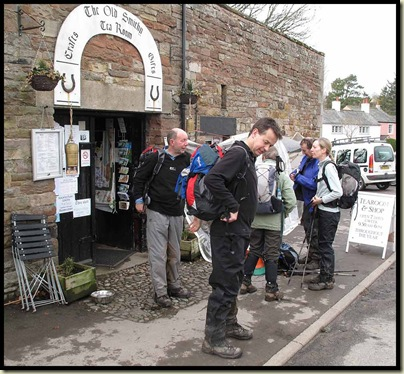 Dick adjusts his corset outside the cafe in Caldbeck