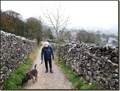 Bruno leads Mike out of Settle