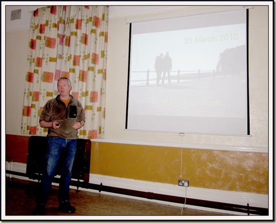 Mick, with his and Gayle's 'Kent to Cape Wrath' slide show