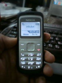 Nokia 1203 on hands