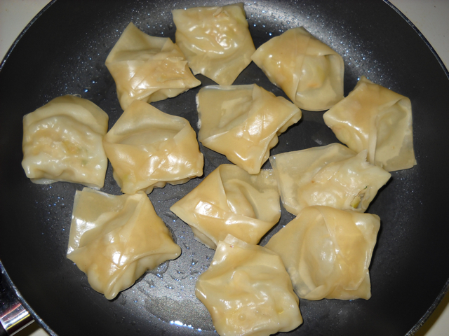 frying pot stickers in pan to get golden brown