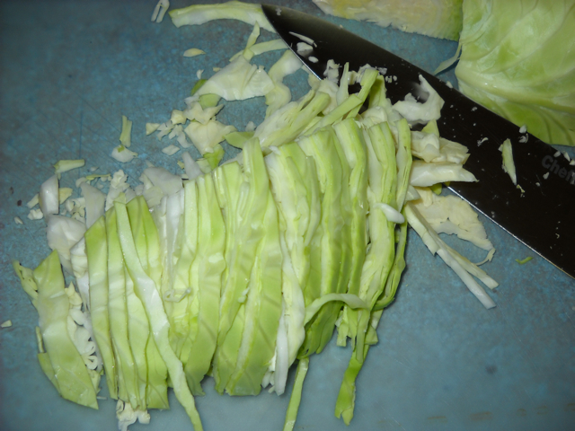 shredded cabbage with knife