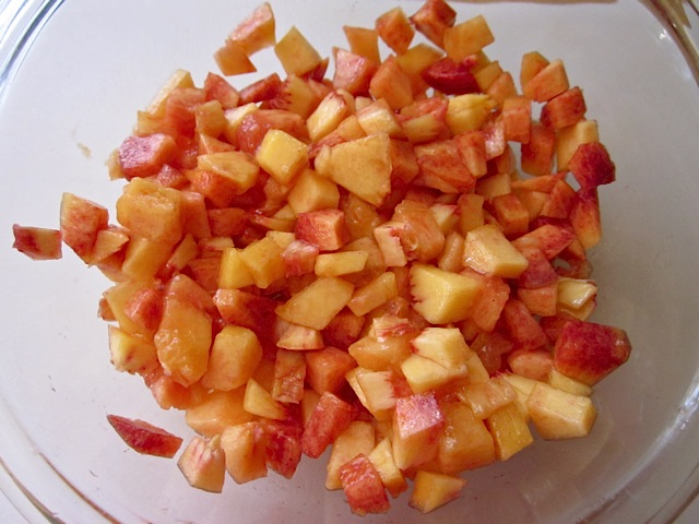 diced peaches in clear mixing bowl
