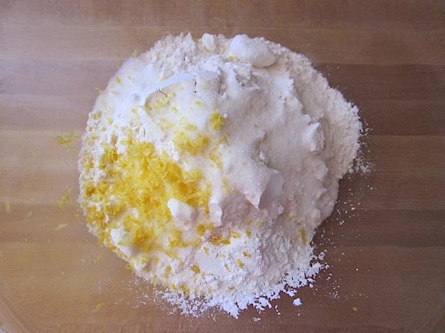 dry ingredients in a bowl (flour, sugar, salt, baking powder and lemon zest)