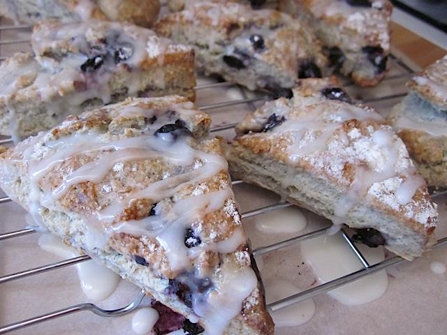 iced blueberry lemon scones on drying sheet