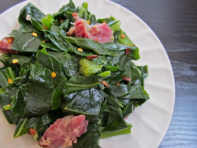 Collard Greens with ham plated on white plate