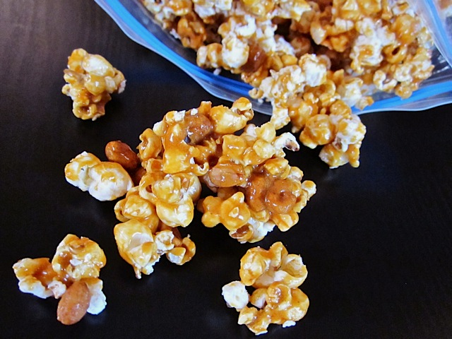 nutty caramel corn falling out of bowl