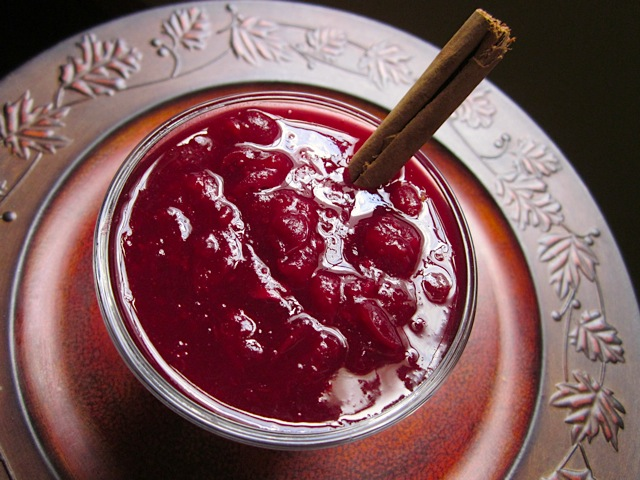 Red Wine Cranberry Sauce in bowl with cinnamon stick