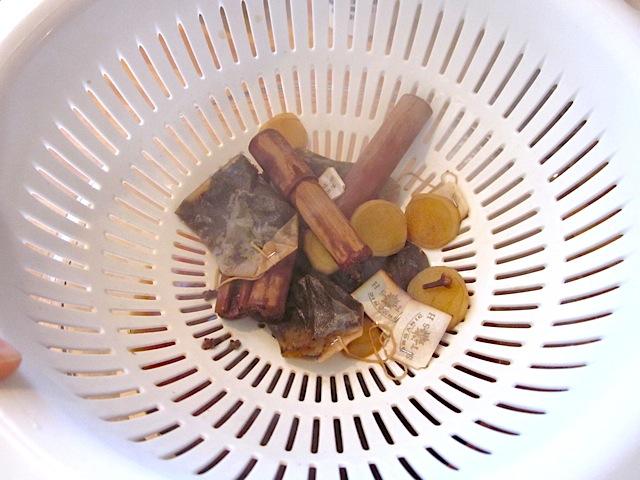 spiced tea drained through strainer