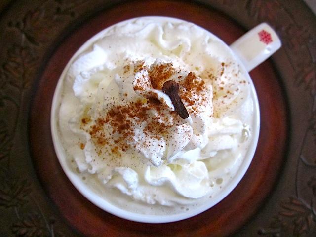 Top view of Homemade Chai tea in mug with whipped cream