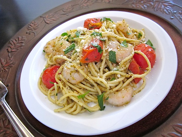 top view of pesto shrimp pasta with parmesan
