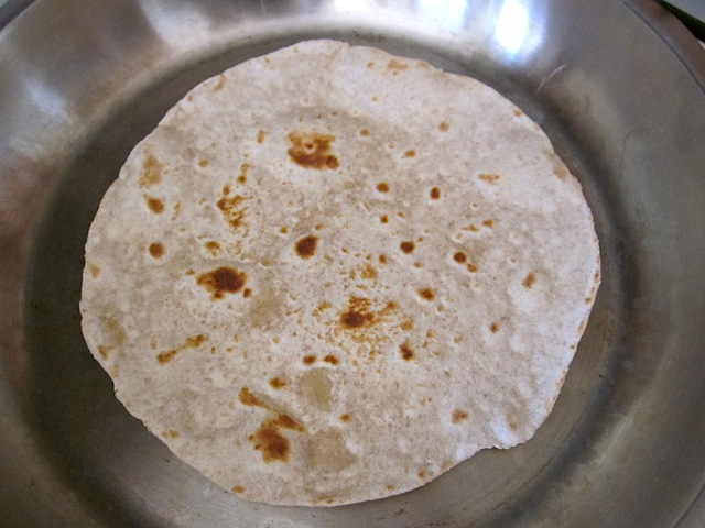 tortilla cooking in pan and turning golden