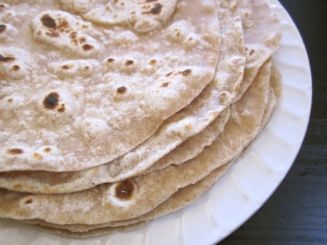Stack of Flour Tortillas whole wheat on white plate
