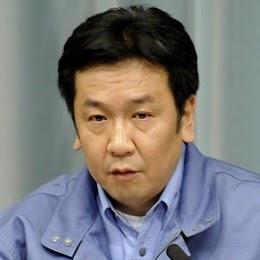 ssociated_Press_3月11日,日本内阁官房长官枝野幸男在一个新闻发布会中讲话,他近来参加了众多新闻发布会。.jpg
