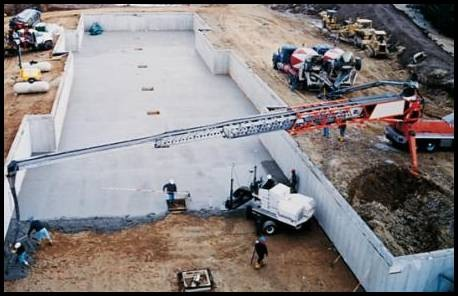 Fig. 10. The conveyor belt is an efficient, portable method of handling concrete. A drop chute prevents concrete from segregating as it leaves the belt; a scraper prevents loss of mortar. Conveyor belts can be operated in series and on extendable booms of hydraulic cranes.