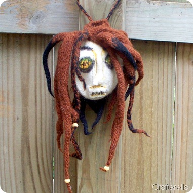 shrunken head bag embelished
