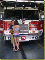 Jenna and Jon David in front of Myrtle Beach Fire Truck where he proposed
