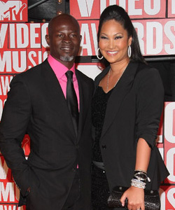 Dijmon Hounsou & Kimora Lee Simmons on the red carpet at the VMA's [image courtesy of Getty images and MTV]