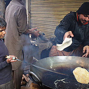 Frying away his dreams. by Maham Elahi - People Street & Candids ( labor, child, pakistan, halwa, old, lahore, puri, breakfast, street )