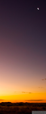 sunset in namibia with rising moon