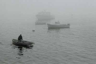 rowboats in fog in maine