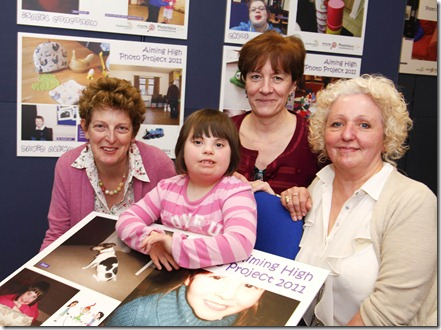 Lily Mae Johnson aged 8 with her photography which was exhibited as part of the Aimin High project  with l-r   Kate Langridge, Ann Clark and Barbara Logan from the Aiming High Project.