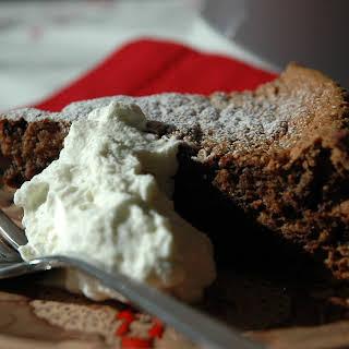 Chocolate Walnut Fig Cake with Grappa and Cardamom Cream.