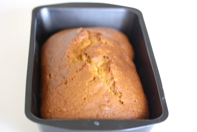 photo of a loaf of pumpkin bread in a loaf pan
