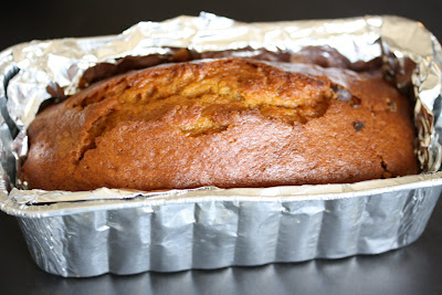 photo of a loaf of Chocolate chip pumpkin bread in a loaf pan
