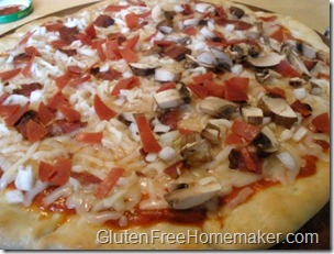 pizza with toppings unbaked