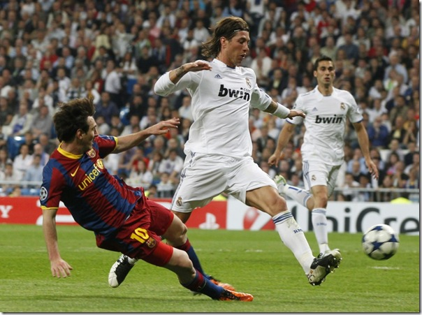 92596-barcelonas-messi-shoots-to-score-his-second-goal-against-real-madrid-d