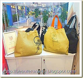 her world 50th anniversary tote bags