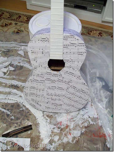 repurposed decoupaged guitar