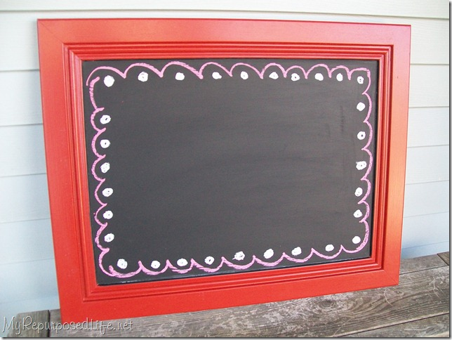 red cabinet door repurposed into chalkboard