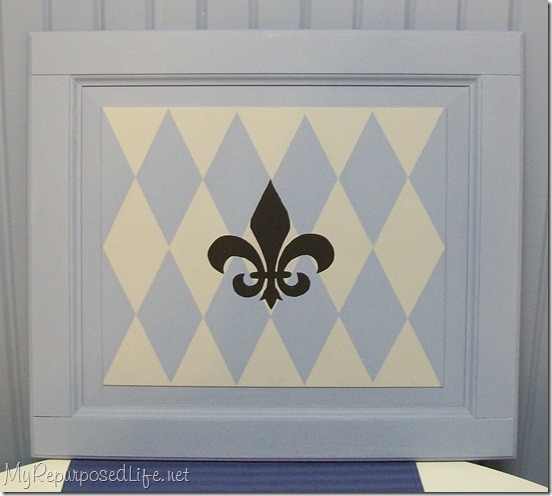 repurposed cabinet door fleur de lis
