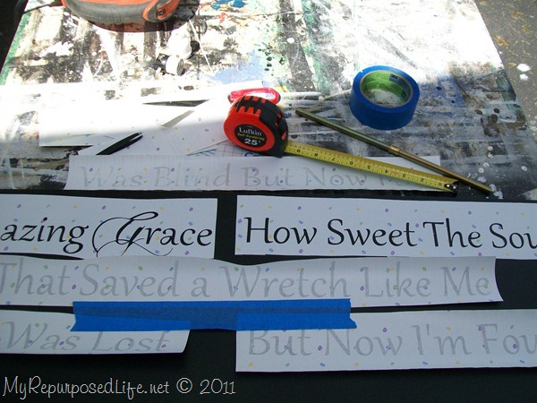 Stenciling a large sign on a headboard MyRepurposedLife.com