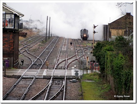 All watered up, Sir Nigel Gresley moves up to the station to pick up more passengers.