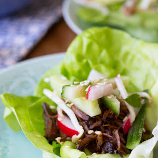 Slow Cooker Korean Beef Lettuce Wraps with a Sesame-Cucumber Salad.