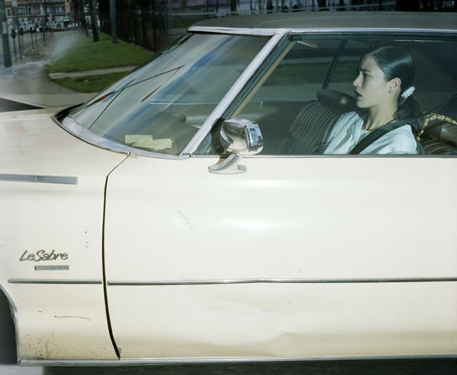 Woman rolling to a stoplight at Wilshire Boulevard and Lafayette Park Place in Hollywood at 2:38–2:39 p.m. on January 18, 1997