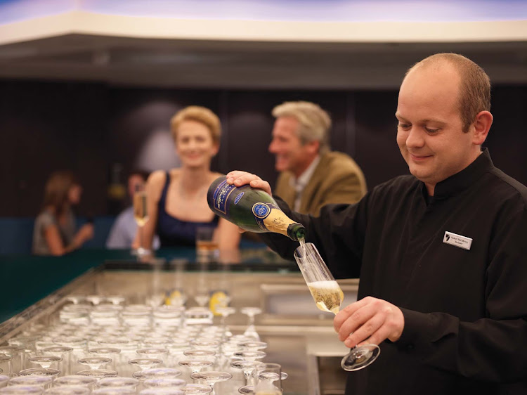 Look forward to a cocktail expertly prepared by the bartender at Seabourn's Sky Bar.