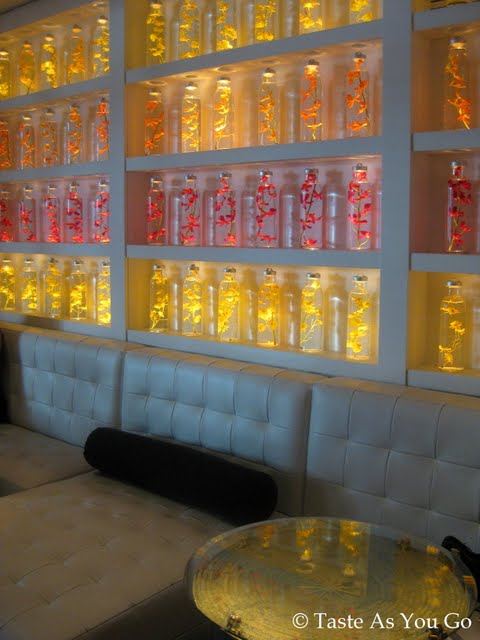 Wall of Decorative Bottles at Kittichai in New York, NY - Photo by Taste As You Go