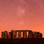 A meteor streaks past stars in the night sky over Stonehenge in Salisbury Plain, southern England August 12, 2010. The Perseid meteor shower is sparked every August when the Earth passes through a stream of space debris left by comet Swift-Tuttle. Picture taken using a long exposure.  REUTERS/Kieran Doherty     (BRITAIN - Tags: ENVIRONMENT SOCIETY IMAGES OF THE DAY)