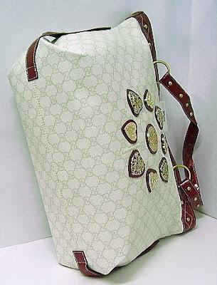 1ce141a0132e Gucci irina medium tote with double handles, snap closure, heart-shaped  gucci crest detail, studs, and inside zip and mobile phone pockets.