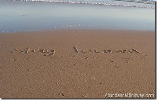 beach stay focused message from abundancehighway.com