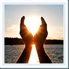 hands holding the sun