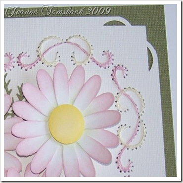 close up embroidered flower card