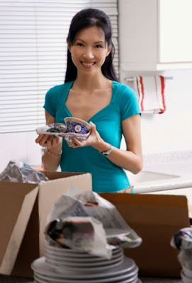 Asian woman happy to pay moving expenses with fast instant payday loans no faxing.