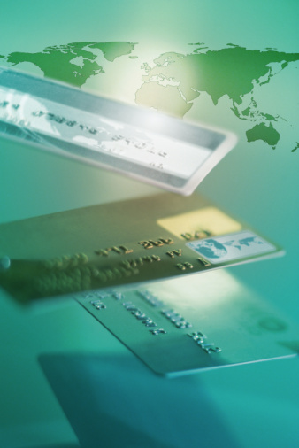 Credit card companies are going into survival mode, charging even good-paying customers high interest rates and cutting their limits.