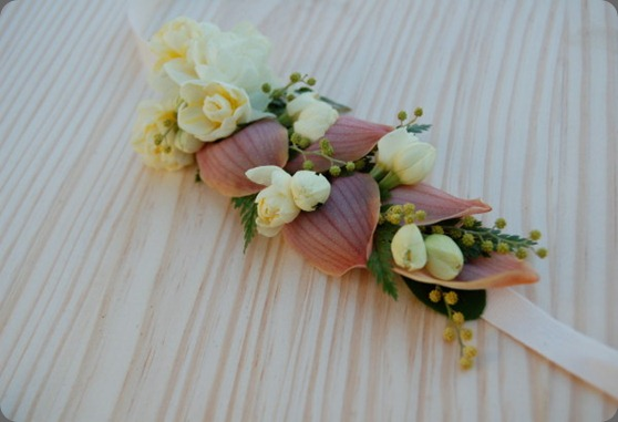 headbands sewn of cymbidium orchid petals, acacia, narcissus, rabbit foot fern, and daphne blossoms the monkey flower group