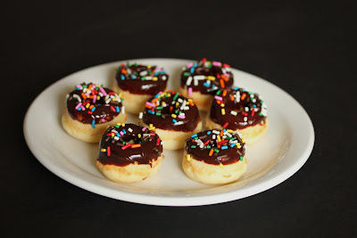 photo of Mini baked donuts with sprinkles on a plate